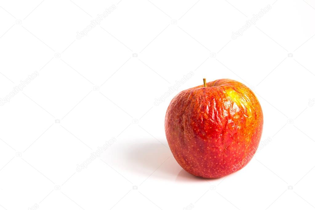 Wizen apple on white background