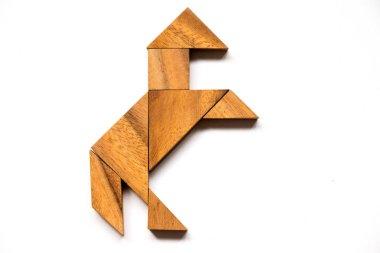 Wooden tangram in horse shape on white background (Concept for energy or start business)