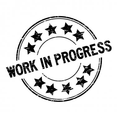 Grunge black work in process with star icon round rubber seal stamp on white background