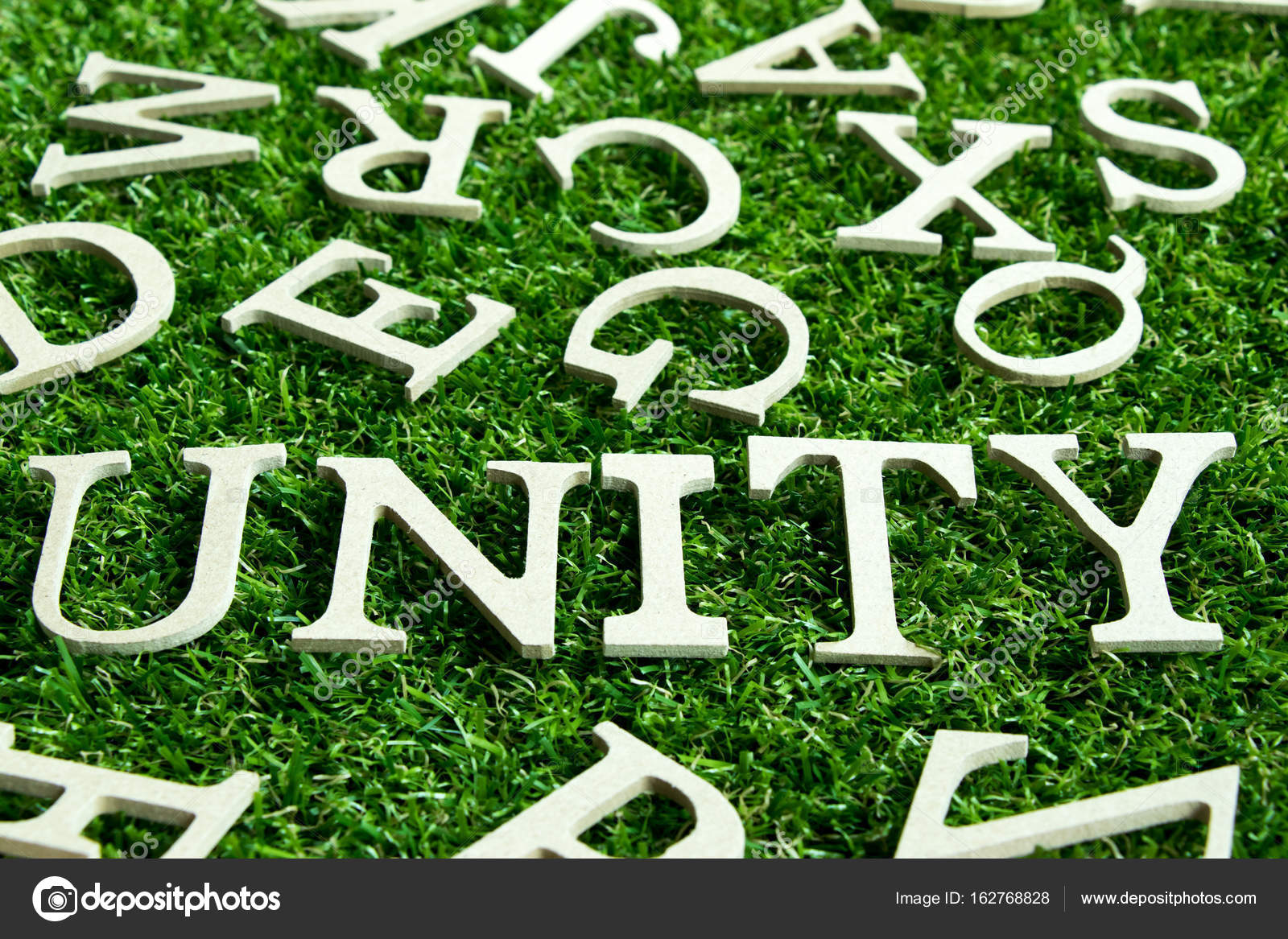 Wording unity on artificial green grass background with