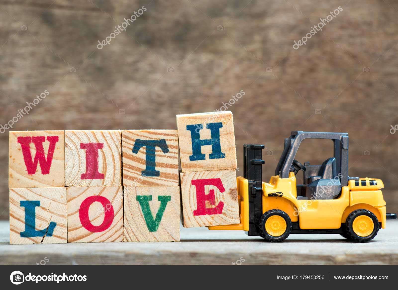Yellow Toy Forklift Hold Letter Block H And E To Complete Word With