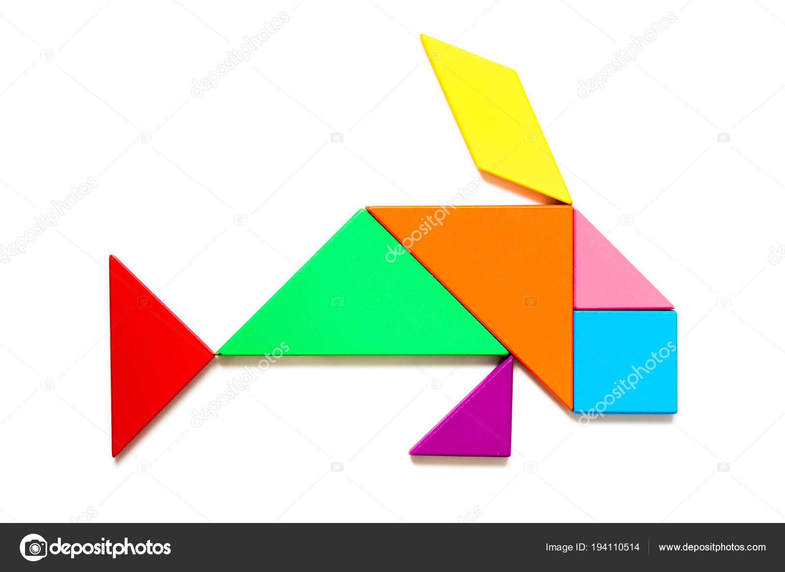 Color wood tangram puzzle in swimming fish shape on white background ...