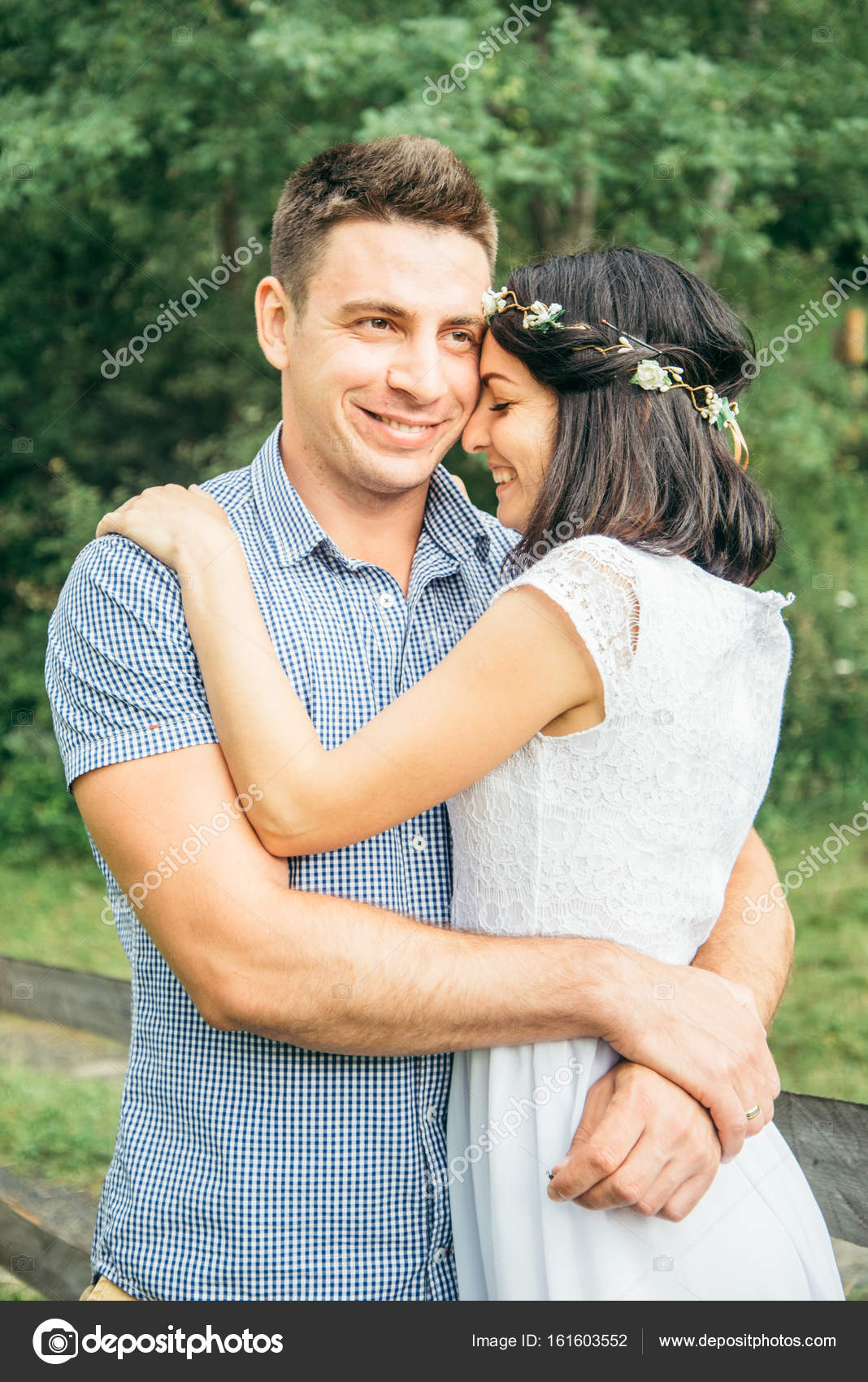 romantic newlywed couple hugging and kissing forest stock photo