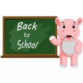 Cartoon Hippo wrote chalk on a blackboard