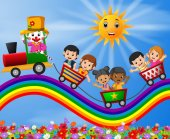 Clown and childrens travelling train on the rainbow