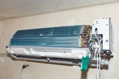 Split air conditioner closeup repair and maintenance concept. Th