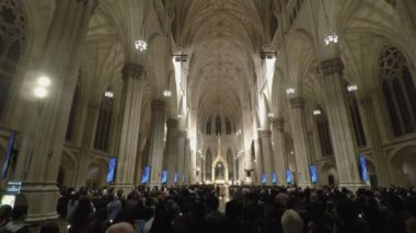 NEW YORK, USA - APRIL 16 2017: St. Patricks Cathedral with people during mass.