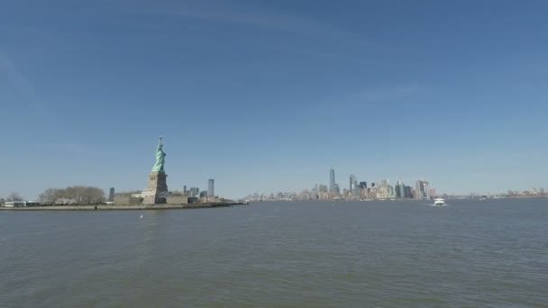 New York Statue of Liberty with Manhattan background view.