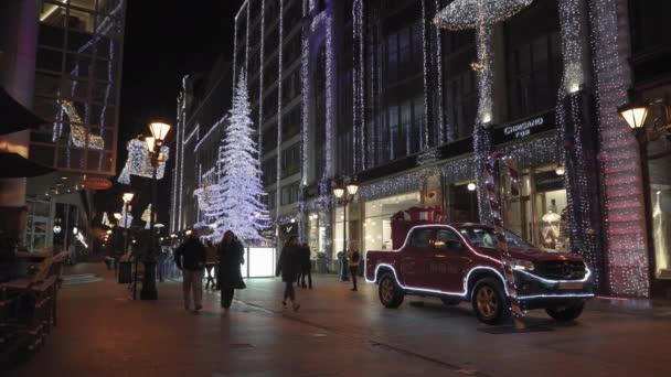 Budapest, Hungary - December 08 2019: Christmas Market  illuminated car  tree at Fashion Street. Adventi Ünnepi díszek a sétálóutcában, üzletekkel a Deak Ferenc utcáig.