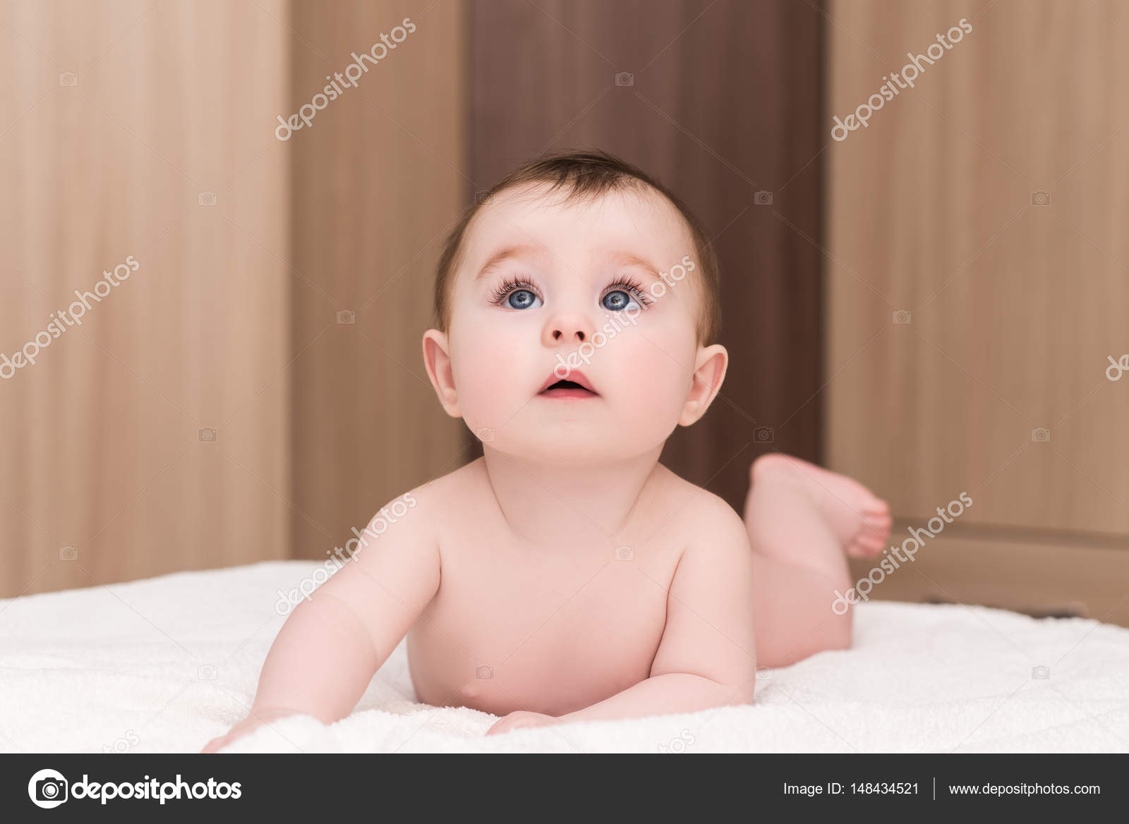 portrait of adorable baby girl with blue eyes — stock photo