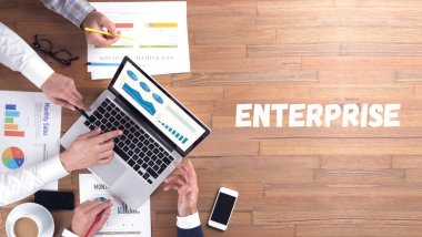 ENTERPRISE word concept on desk background