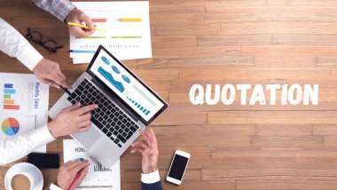 QUOTATION word concept on desk background