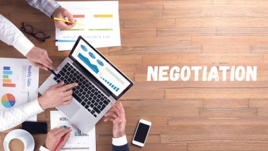 NEGOTIATION word concept on desk background