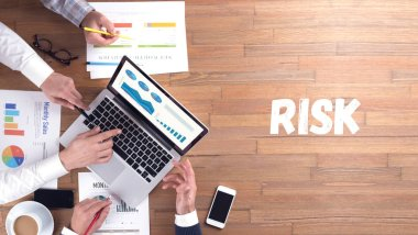 RISK concept, professionals team at work