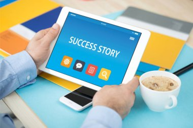 SUCCESS STORY CONCEPT ON TABLET