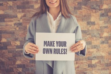 Woman presenting MAKE YOUR OWN RULES CONCEPT