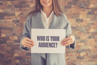 Woman presenting WHO IS YOUR AUDIENCE CONCEPT