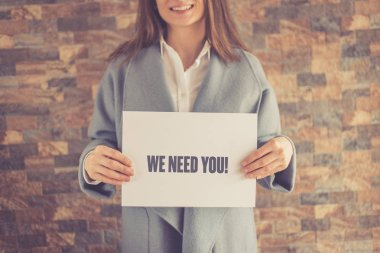Woman presenting  WE NEED YOU CONCEPT