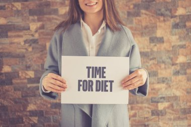 Woman presenting Diet CONCEPT