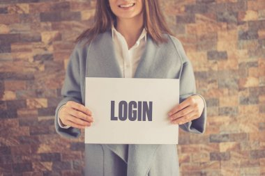 Woman presenting LOGIN CONCEPT