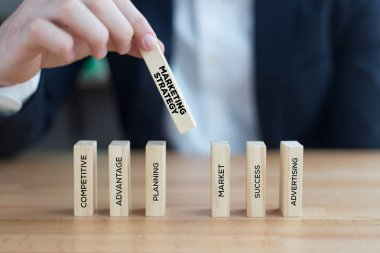 businessman playing with blocks