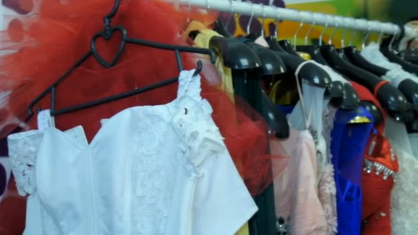 Womens dresses hanging on a hanger in the wardrobe.
