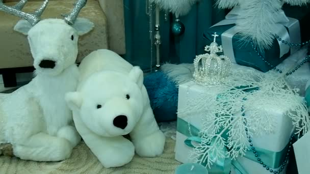 White bears. Presents under decorated Christmas tree.
