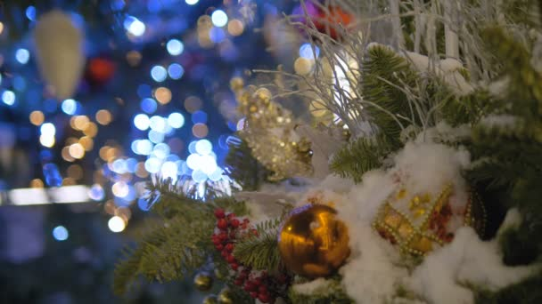 christmas toys hanging on the christmas tree colored garland the city is decorated for