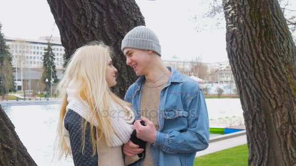 A beautiful blonde and her boyfriend are talking on a date.