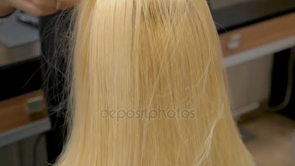The type of hairstyle of a blonde woman