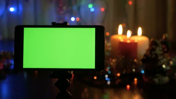 smartphone with a green screen new year background blurred a great opportunity to add