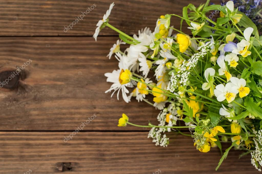 Wooden background with wildflowers