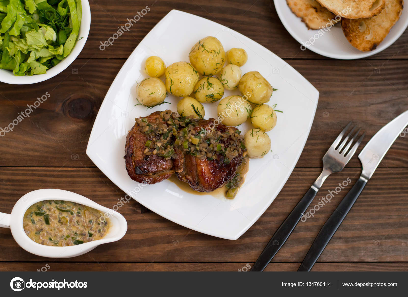 Pork Medallions In Mushroom Sauce With New Potatoes Restaurant - Table top for restaurant supply