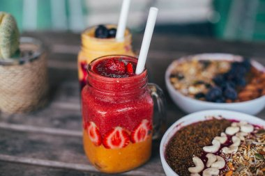 fruit smoothies in glass jars