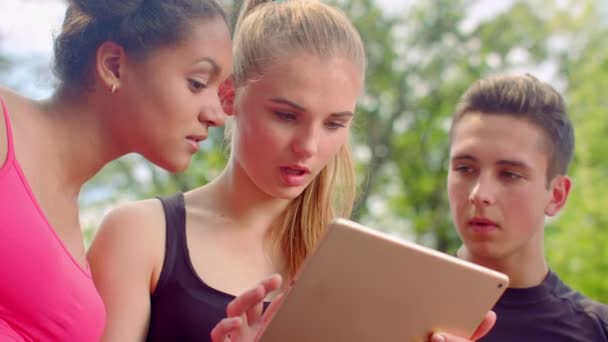 Friends looking tablet. Shocked faces. Surprised people. Young people tablet