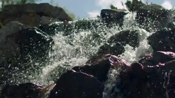 Water splashes in slow motion. Closeup of waterfall. Splashes of water