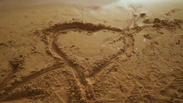 Heart drawn in the sand. Beach sand background with heart.