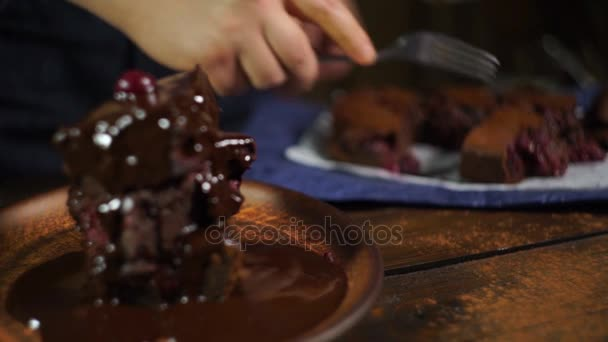 Men tasting chocolate cake. Brownie stack with chocolate on plate