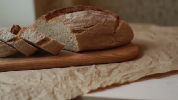 Sliced bread on wooden board. Slices of homemade bread on cutting board