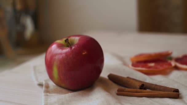 Apple fruit and cinnamon sticks on kitchen table. Apple and grapefruit slices