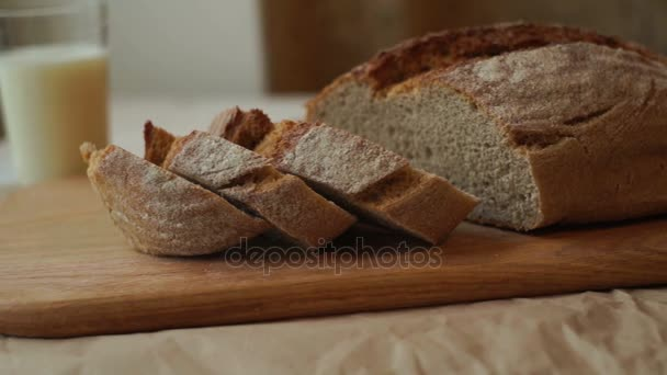 Pieces of bread on cutting board at kitchen. Closeup of wheat bread slices