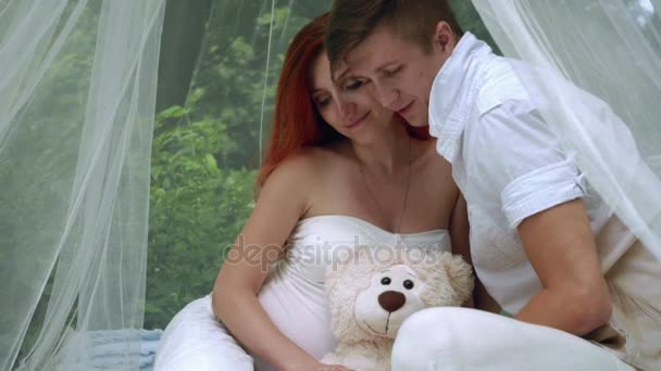 Love couple hugging tender in white wedding decorations. Wedding couple