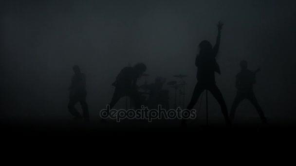 Rockový koncert hudby. Rocková skupina silueta na hudební koncert