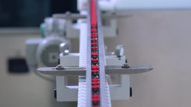Medicine bottles on pharmaceutical manufacturing line. Automated production line