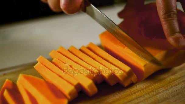 Raw pumpkin cut. Healthy food. Cutting fresh pumpkin. Pumpkin sliced