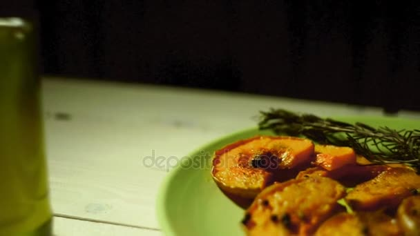 Baked pumpkin slices with rosemary herb. Baked pumpkin pieces