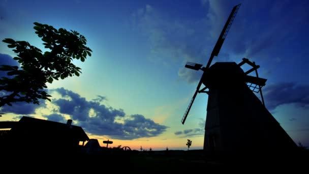 Village sunrise timelapse. Rural windmill silhouette. Sunrise landscape