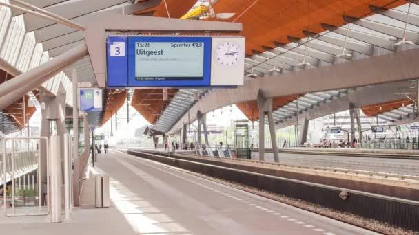 Moving traffic of railway train. Railway station platform. Rail road track