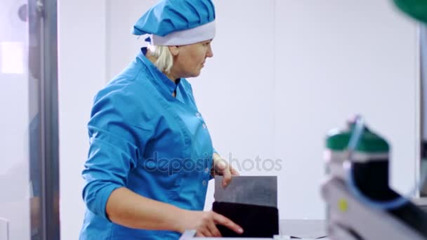 Pharmaceutical worker. Pharmaceutical manufacturing line. Pharmaceutical factory