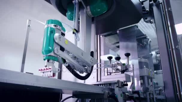 Robotic arm working at automated production line. Modern technology